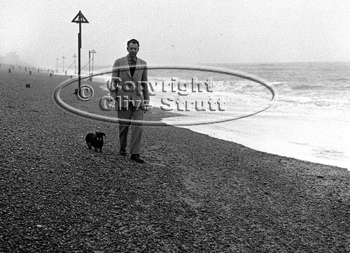 Benjamin Britten on Aldeburgh beach with dog