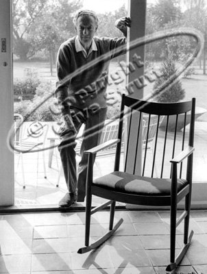 Benjamin Britten at Red House door with rocking chair