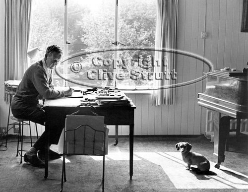 Benjamin Britten at study desk with dog