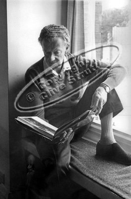 Benjamin Britten siting at window reading