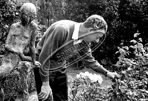 Benjamin Britten in Red House Garden with roses