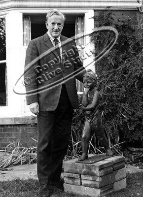 Peter Pears leaning on statue in Red House garden