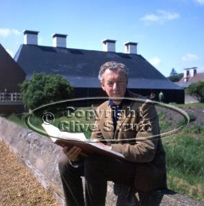 Benjamin Britten outside Snape Maltings with score